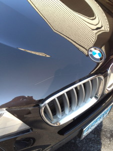A deep scratch to the hood of this BMW was a good candidate for this service.
